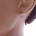 Oval pink faceted cubic zirconia post earrings set in 4 prong setting shown on mannequin