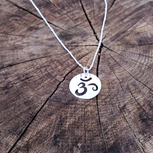 OM cut out sterling silver round necklace