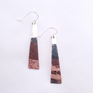Silver long tapered textured earrings.