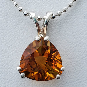 Close up view of faceted citrine pendant