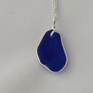 Back view of ridged cobalt blue sea glass necklace with sterling silver wire wrap.