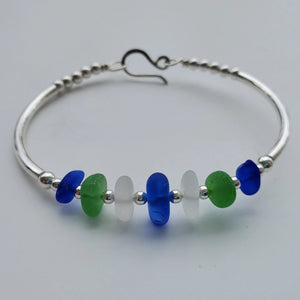 Sterling silver bracelet with 7 pieces of sea glass and silver beads with hook clasp..