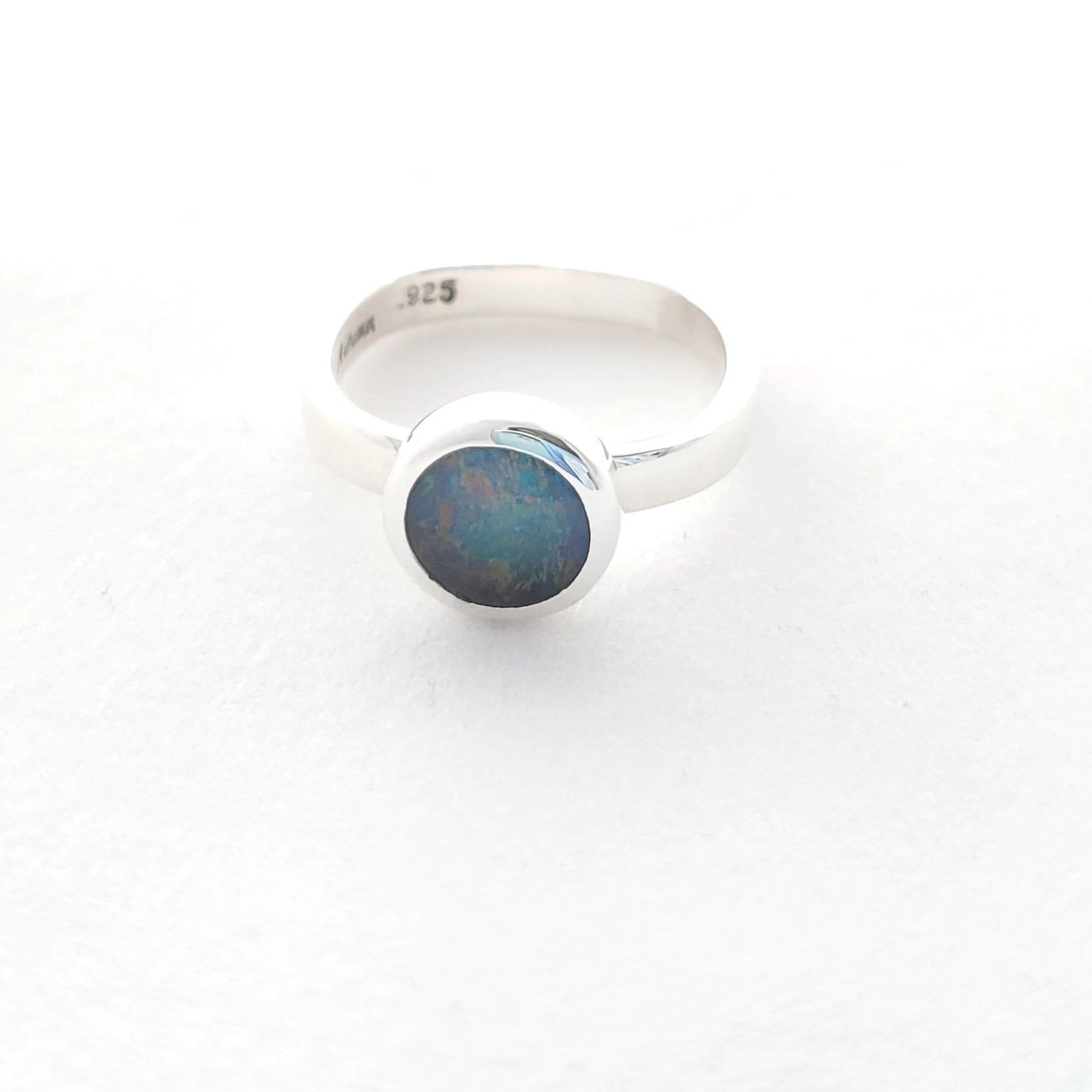 Laying down face on view of opal triplet ring.