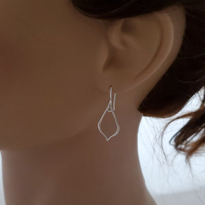 small silver pointed teardrop earrings shown on mannequin