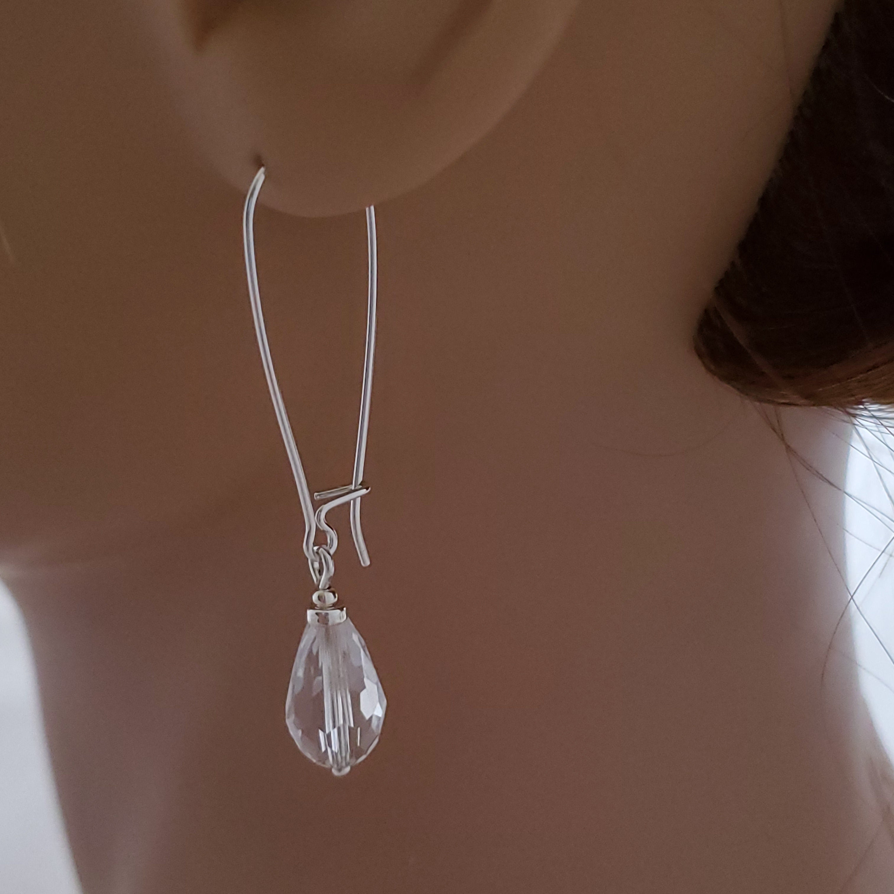 displayed on mannequin, clear faceted crystal long dangle earrings