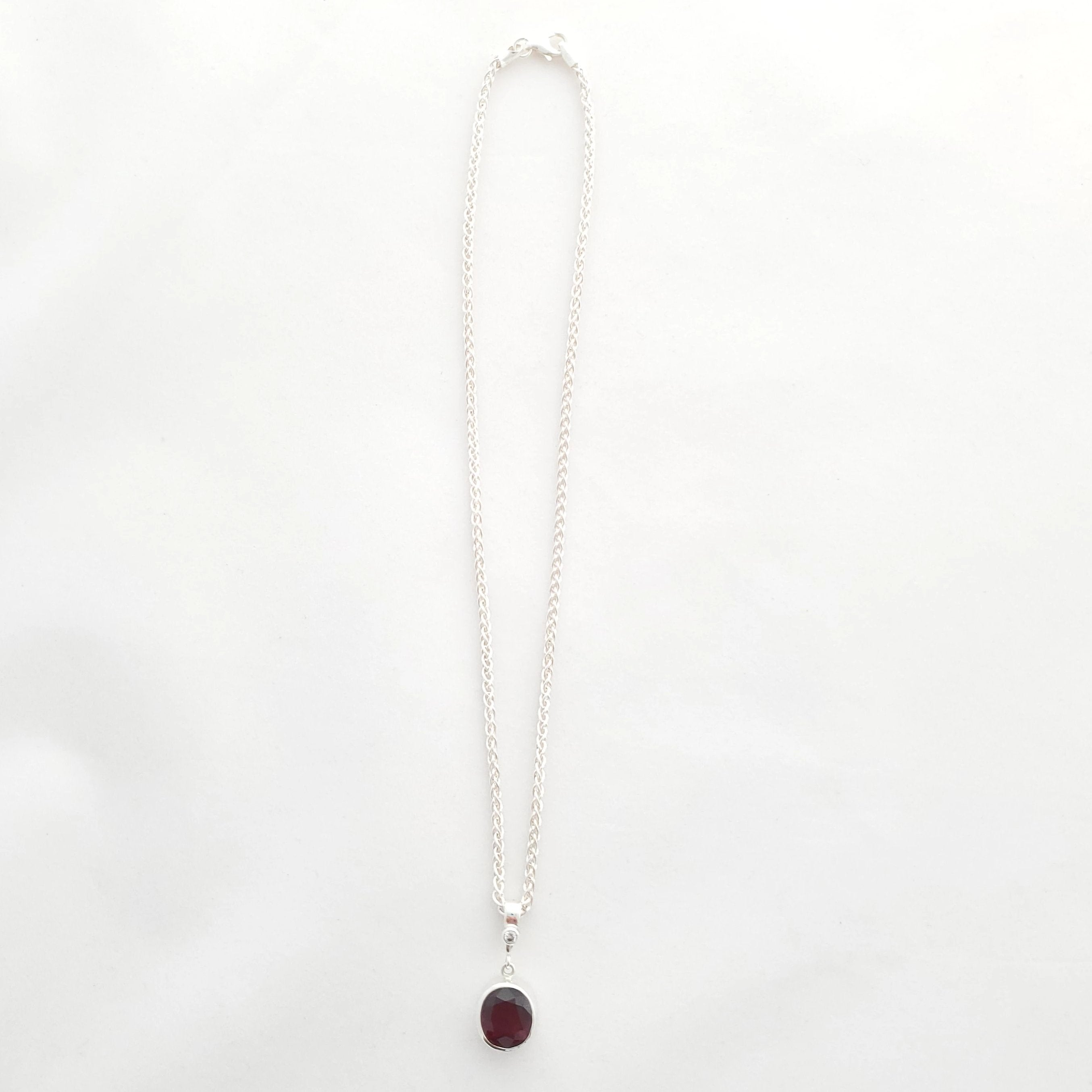 view from far away, garnet and cz necklace shown on wheat chain with lobster clasp