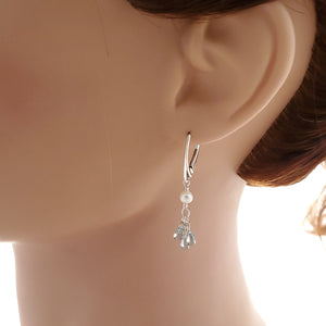 Blue zircon and fresh water pearl earrings shown on mannequin.