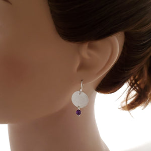 Brushed silver and amethyst dangle earrings shown on mannequin