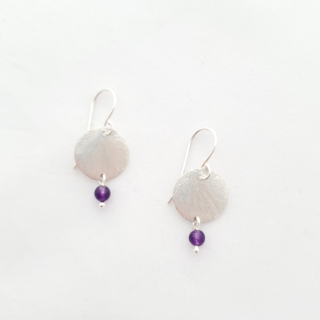Round brushed silver disc dangle earrings with small round amethyst beads hanging from bottom.