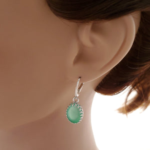 Bright green Chrysoprase earrings shown on mannequin.
