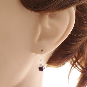 Purple crystal earrings shown on mannequin