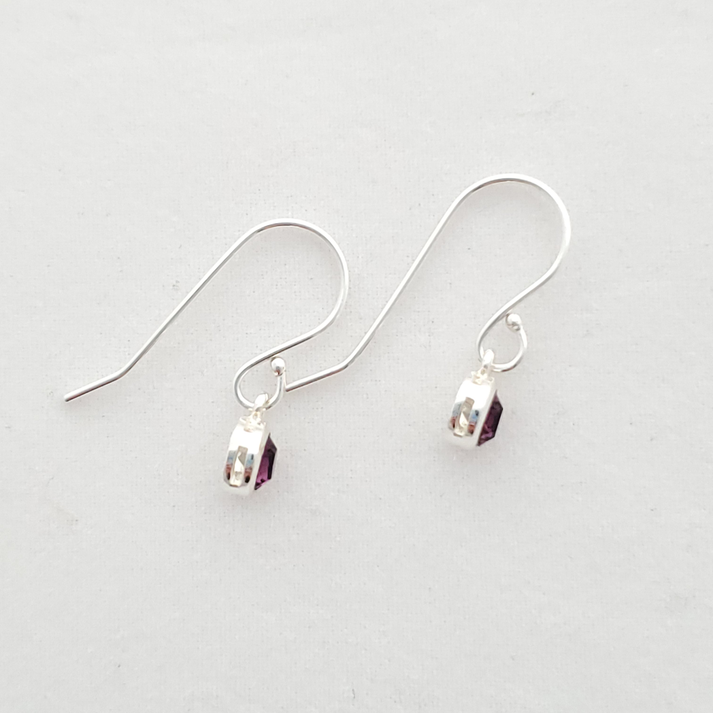 Side view of February Swarovski crystal dangle earrings in sterling silver