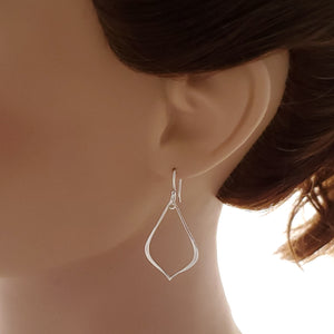 pointed sterling silver teardrop earrings shown on mannequin