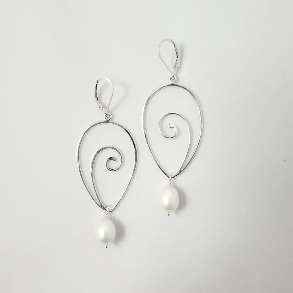 Sterling silver upside down teardrop shape with spiral in center, and fresh water pearl dangling from bottom. Lever back earring wires