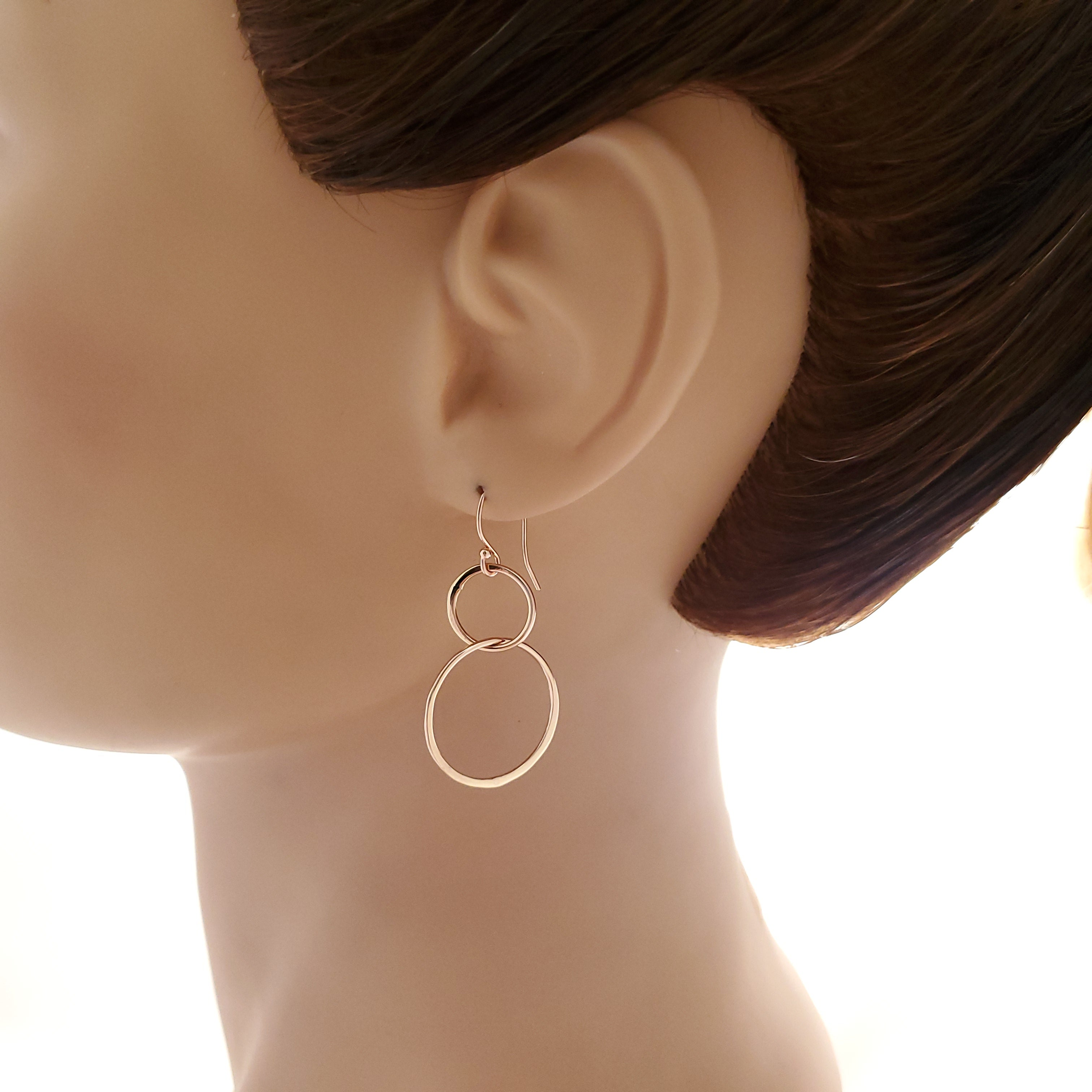 Double open circle rose gold-filled dangle earring shown on mannequin
