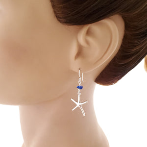 Silver starfish and blue sea glass dangle earring shown on mannequin