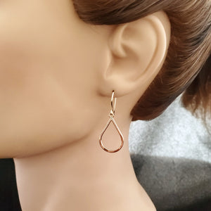 Gold-filled open teardrop dangle earring shown on mannequin.