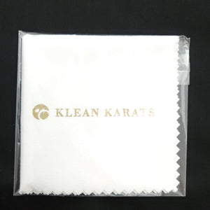 White jewelry polishing cloth folded and wrapped in clear plastic packaging