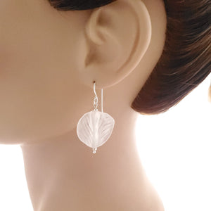White leaf round earring shown on mannequin