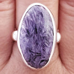 purple charoite ring shown on real hand.