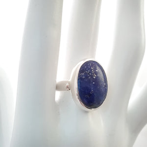 Close up view of silver lapis ring on mannequin.