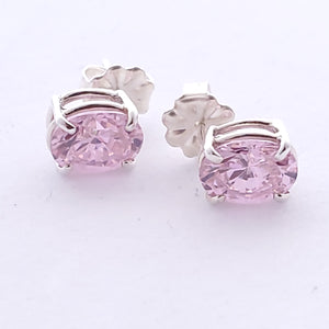 Oval pink faceted prong set post earrings