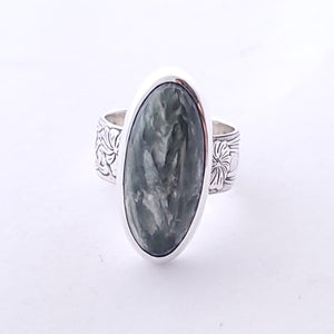 Bezel set green with white patterning Seraphinite stone ring.