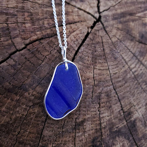 Cobalt blue sea glass framed in silver wire necklace