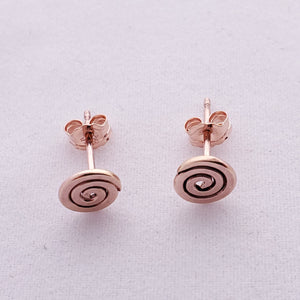 Rose gold-filled spiral post earrings, showing view from above with earring backs