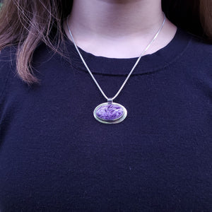 Oval charoite necklace shown on model