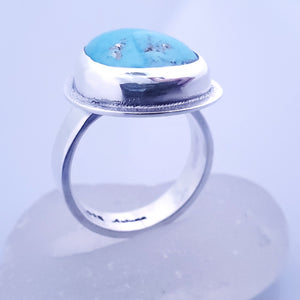 side view of turquoise and silver ring