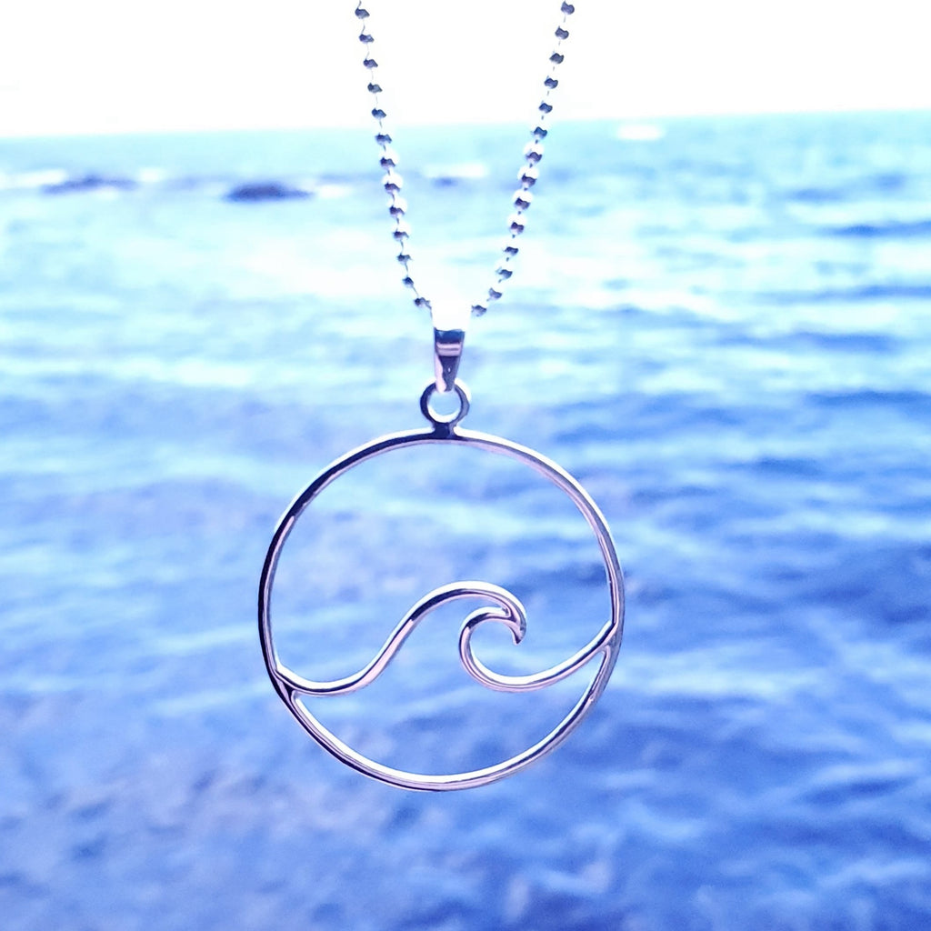 Wave necklace in circle with ocean in background