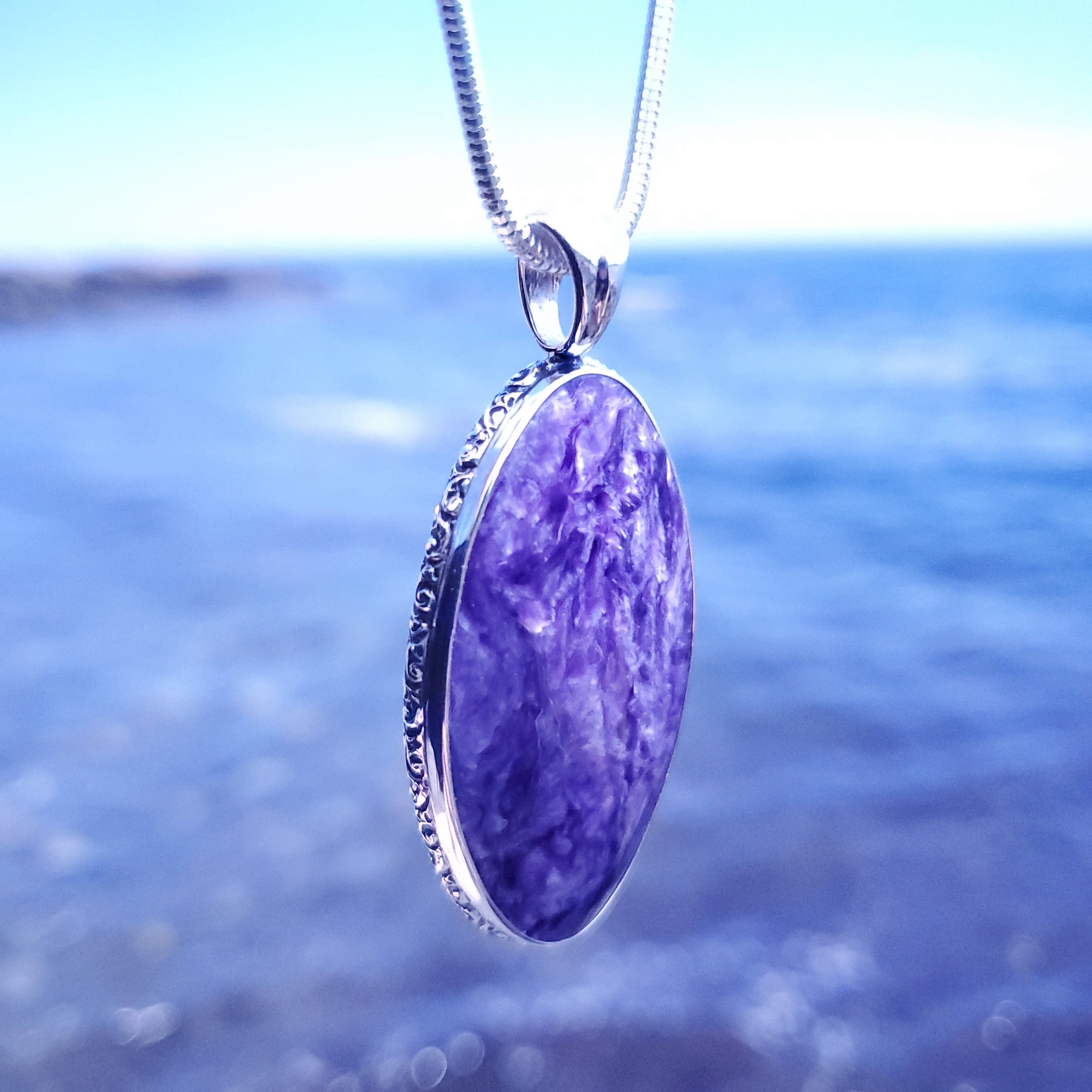 Charoite necklace with ocean in background