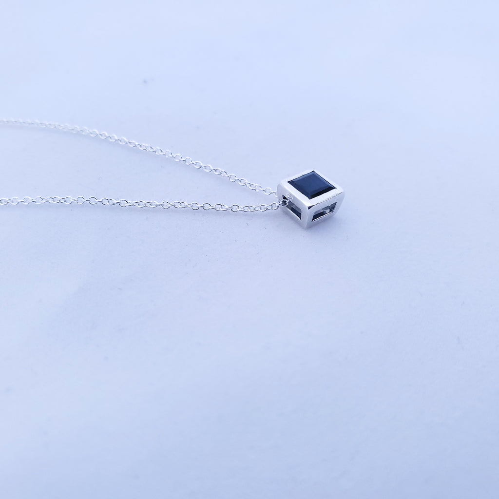 side view of bezel set square sapphire pendant