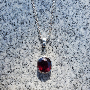 Oval garnet and cubic zirconia necklace