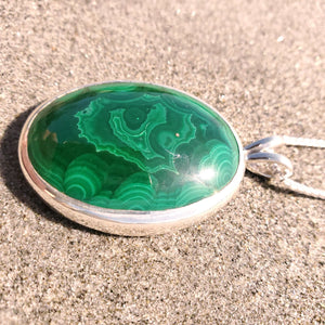 close up view of malachite showing swirling bands or color