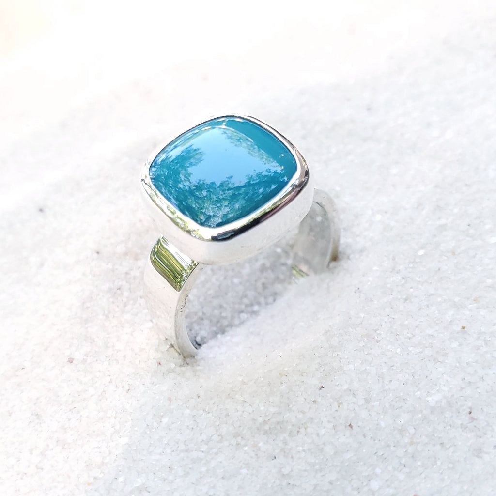 Silver ring with square bezel set turquoise