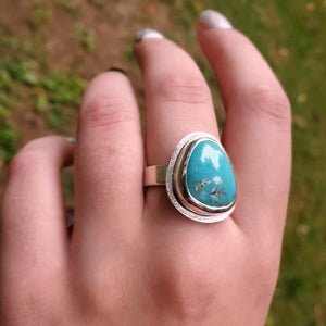 Turquoise ring shown on hand
