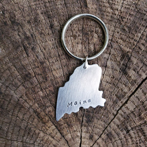 Maine shaped key chain with Maine stamped inside