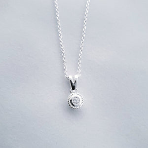 Small round cubic zirconia necklace in sterling silver with rope border