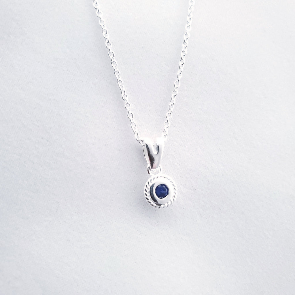 blue faceted stone in silver necklace