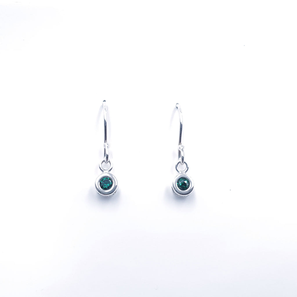 Simulated emerald bezel set earrings