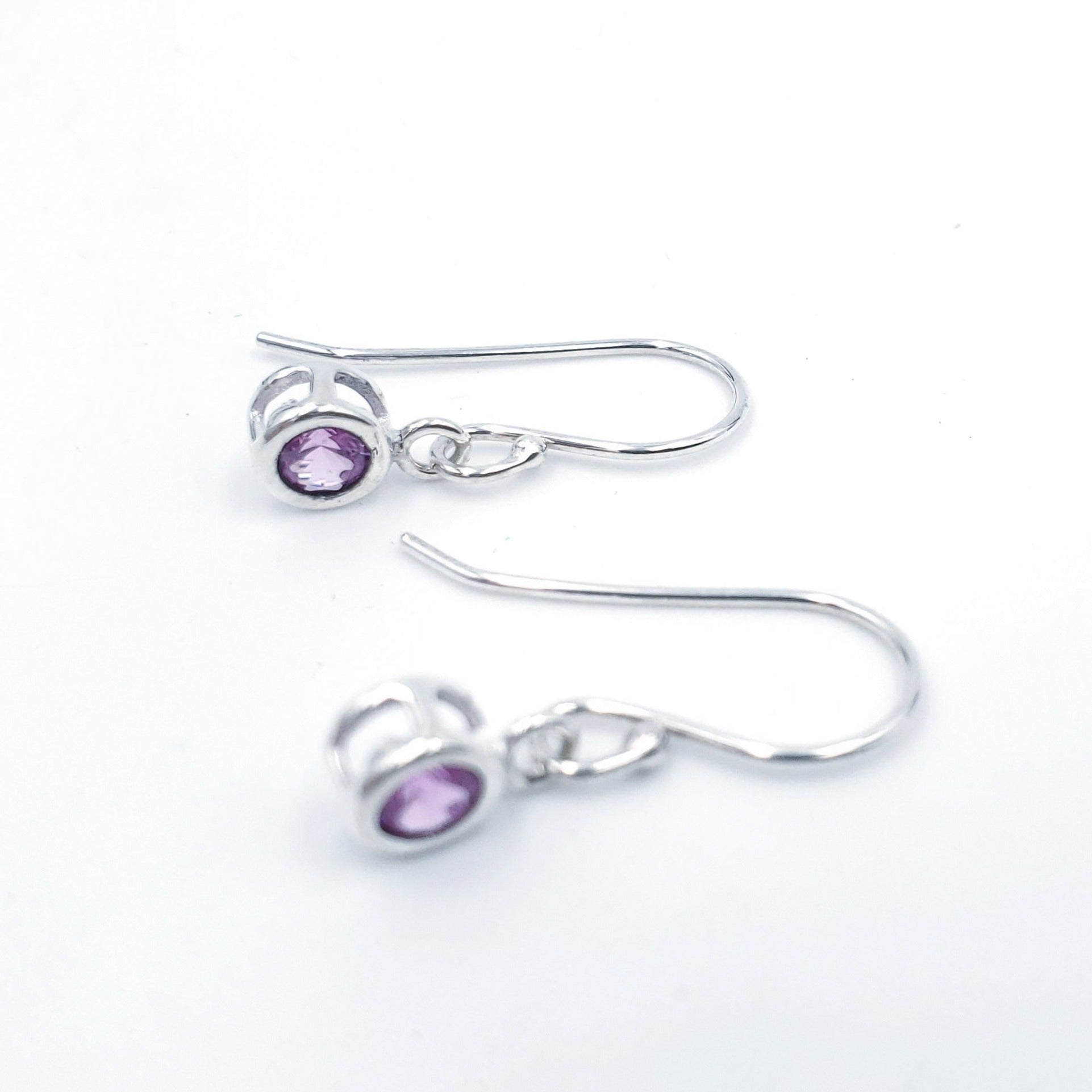 Silver and pink faceted dangle earrings