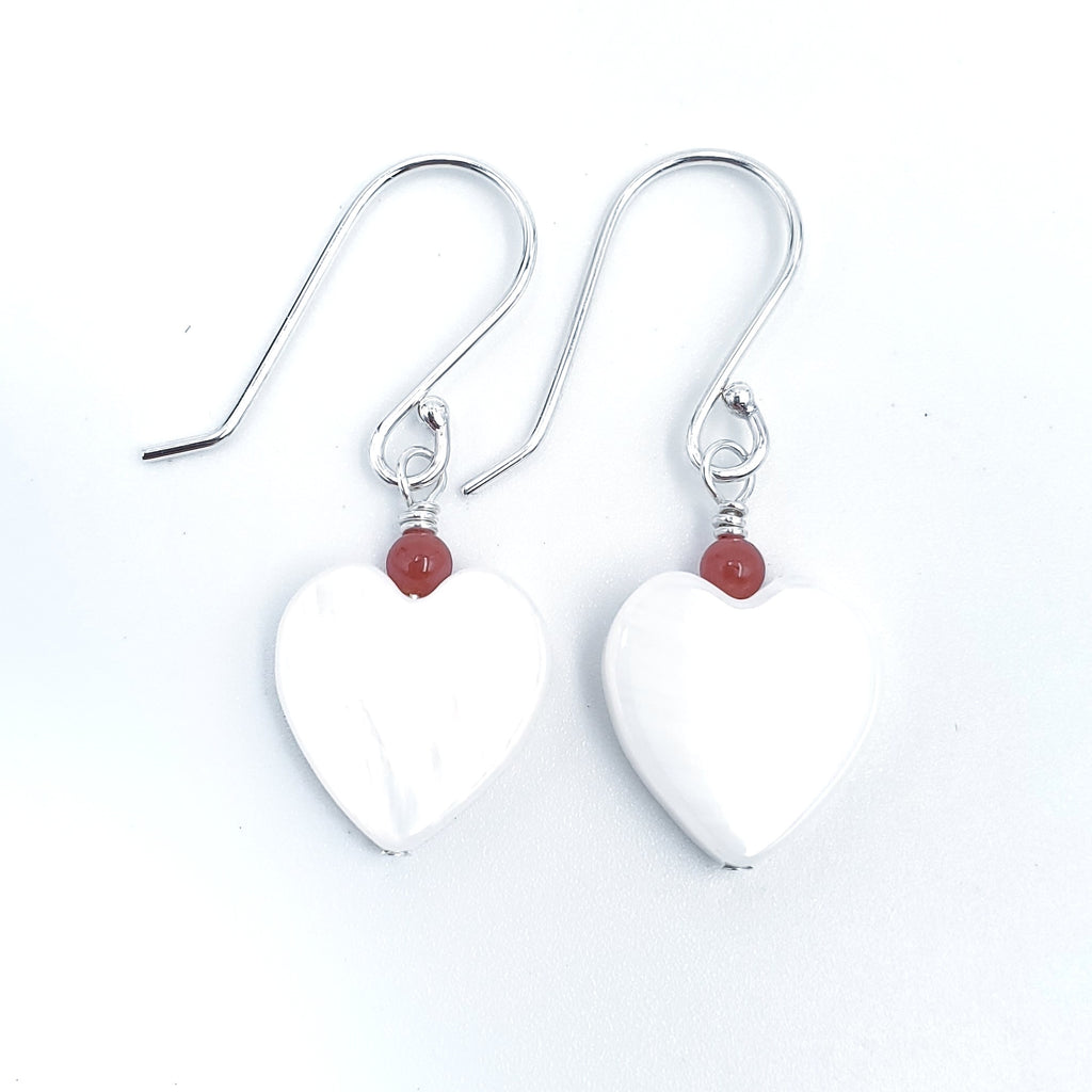Mother of pearl heart beads with small round red coral bead on top