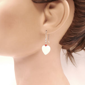 Mother of pearl and coral earring shown on mannequin