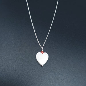 White mother of pearl heart with round coral bead on top necklace
