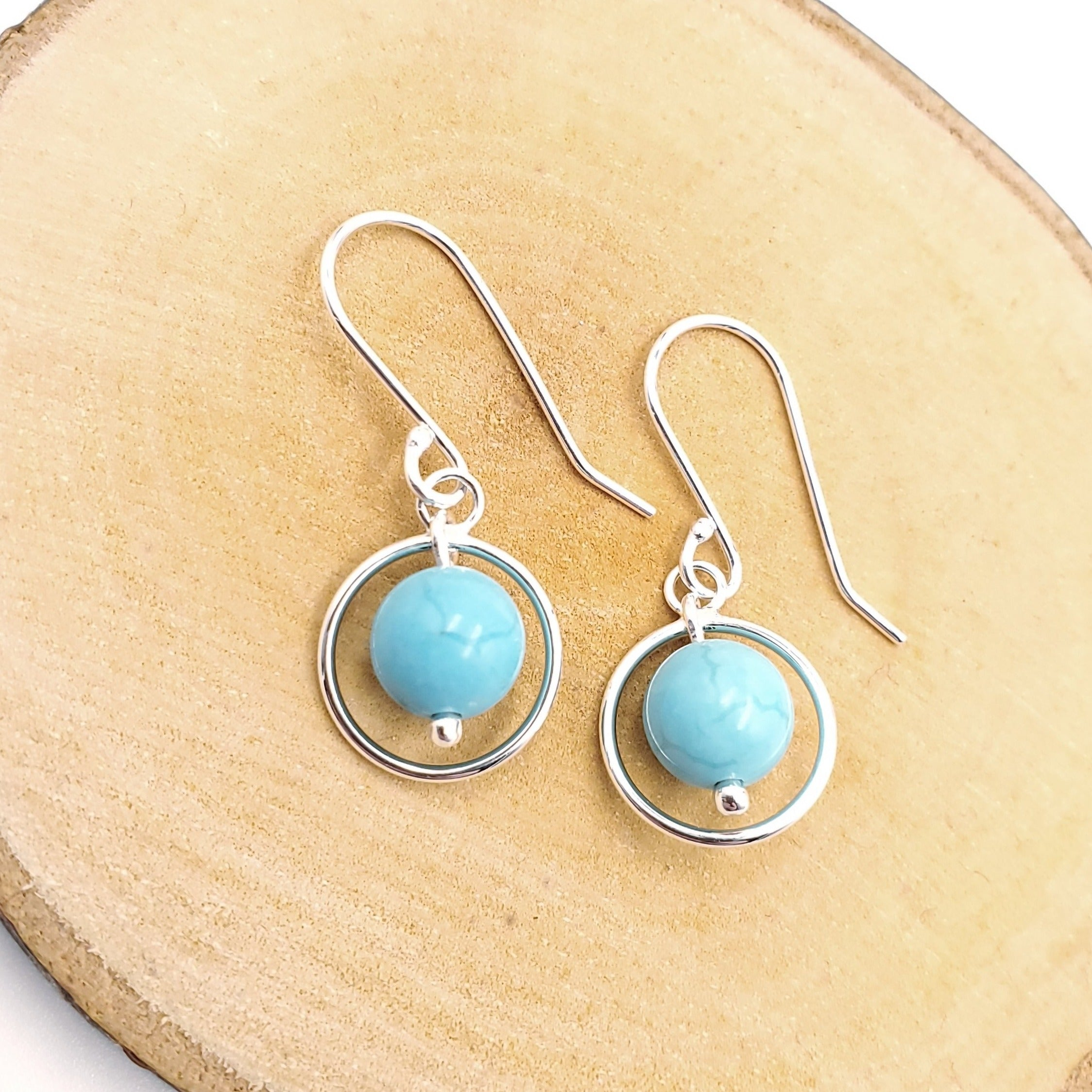 Round turquoise beads with silver circle border earrings
