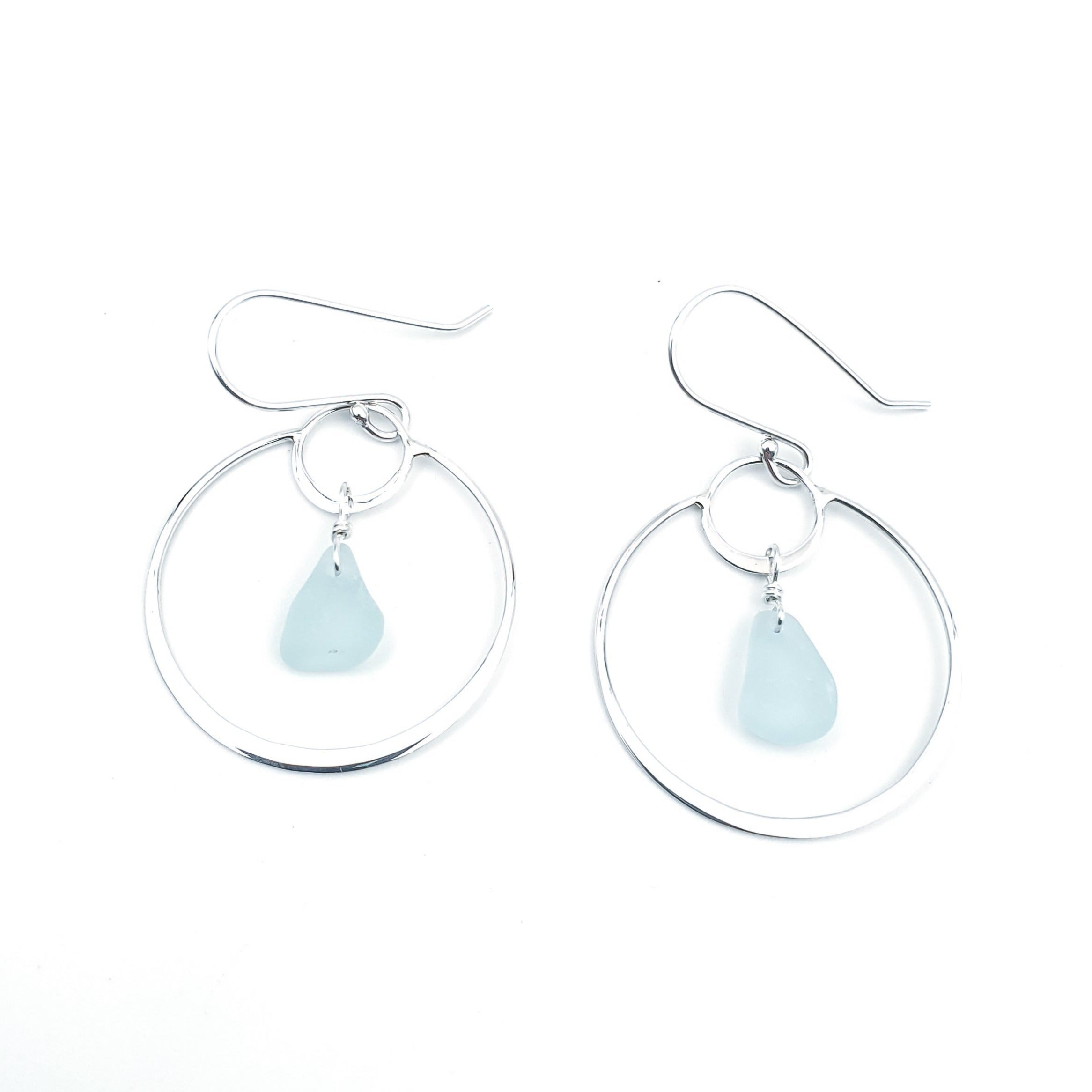 Small circle inside larger circle silver earrings with aqua sea glass inside