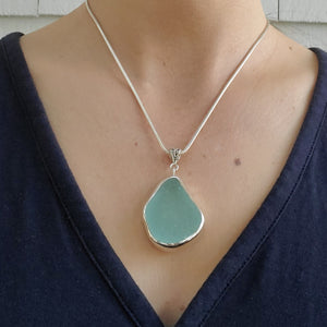 Aqua sea glass necklace on model