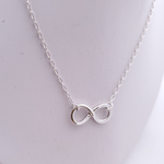 Sterling silver infinity necklace close up view